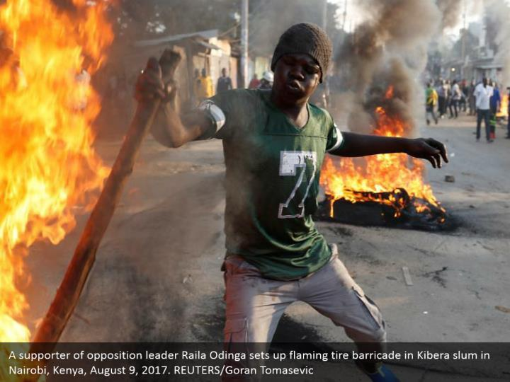 A supporter of opposition leader Raila Odinga sets up flaming tire barricade in Kibera slum in Nairobi, Kenya, August 9, 2017. REUTERS/Goran Tomasevic