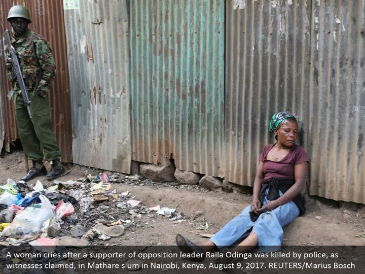 A woman cries after a supporter of opposition leader Raila Odinga was killed by police, as witnesses claimed, in Mathare slum in Nairobi, Kenya, August 9, 2017. REUTERS/Marius Bosch