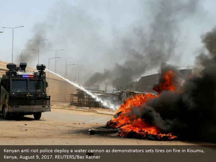 Kenyan anti riot police deploy a water cannon as demonstrators sets tires on fire in Kisumu, Kenya, August 9, 2017. REUTERS/Baz Ratner