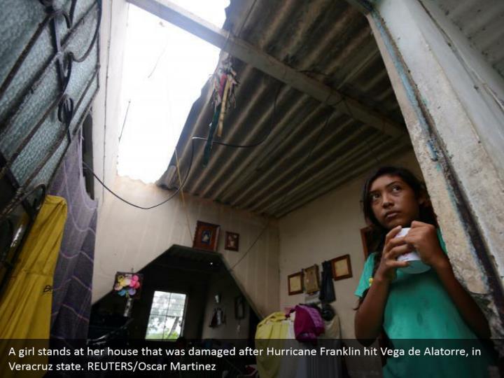 A girl stands at her house that was damaged after Hurricane Franklin hit Vega de Alatorre, in Veracruz state. REUTERS/Oscar Martinez