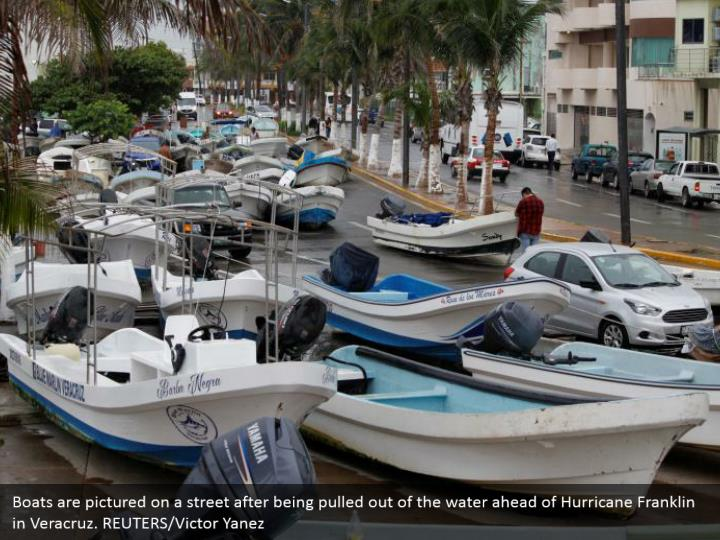 Boats are pictured on a street after being pulled out of the water ahead of Hurricane Franklin in Veracruz. REUTERS/Victor Yanez