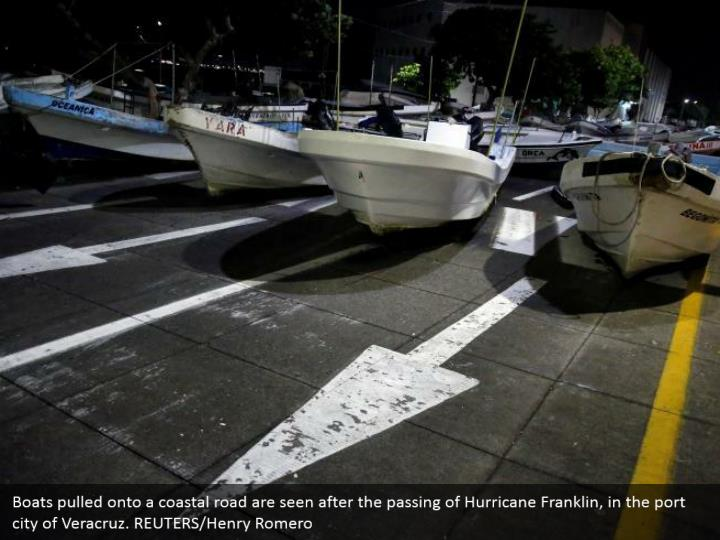 Boats pulled onto a coastal road are seen after the passing of Hurricane Franklin, in the port city of Veracruz. REUTERS/Henry Romero