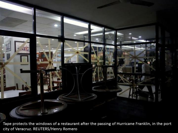 Tape protects the windows of a restaurant after the passing of Hurricane Franklin, in the port city of Veracruz. REUTERS/Henry Romero
