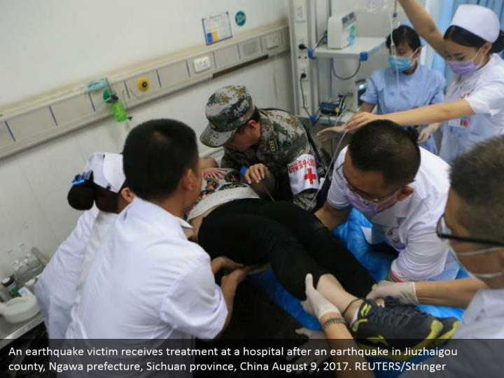 An earthquake victim receives treatment at a hospital after an earthquake in Jiuzhaigou county, Ngawa prefecture, Sichuan province, China August 9, 2017. REUTERS/Stringer