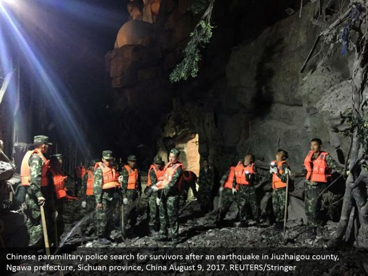 Chinese paramilitary police search for survivors after an earthquake in Jiuzhaigou county, Ngawa prefecture, Sichuan province, China August 9, 2017. REUTERS/Stringer
