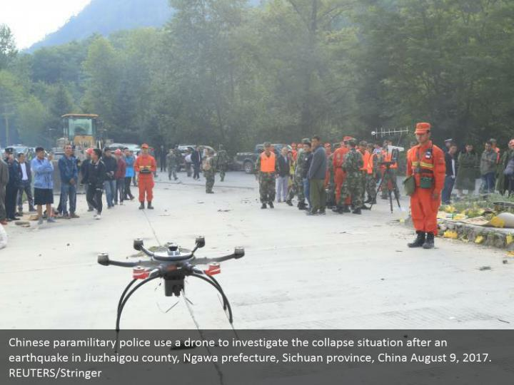 Chinese paramilitary police use a drone to investigate the collapse situation after an earthquake in Jiuzhaigou county, Ngawa prefecture, Sichuan province, China August 9, 2017. REUTERS/Stringer