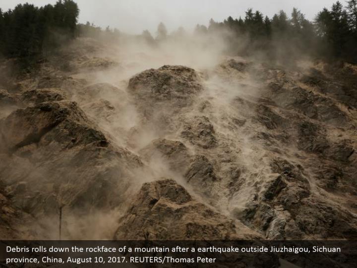 Debris rolls down the rockface of a mountain after a earthquake outside Jiuzhaigou, Sichuan province, China, August 10, 2017. REUTERS/Thomas Peter
