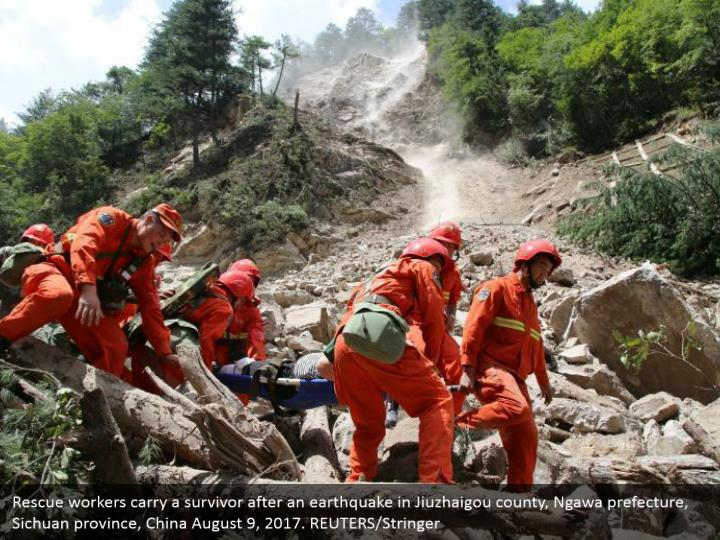Rescue workers carry a survivor after an earthquake in Jiuzhaigou county, Ngawa prefecture, Sichuan province, China August 9, 2017. REUTERS/Stringer