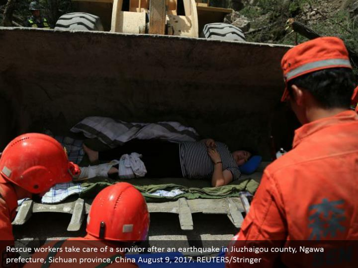 Rescue workers take care of a survivor after an earthquake in Jiuzhaigou county, Ngawa prefecture, Sichuan province, China August 9, 2017. REUTERS/Stringer