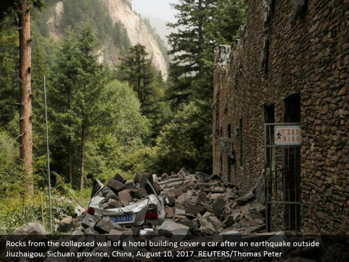 Rocks from the collapsed wall of a hotel building cover a car after an earthquake outside Jiuzhaigou, Sichuan province, China, August 10, 2017. REUTERS/Thomas Peter