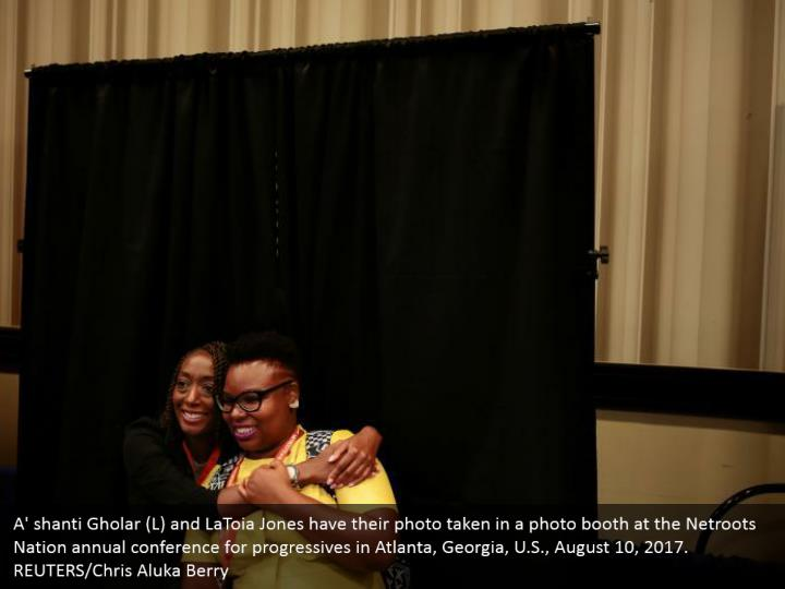 A' shanti Gholar (L) and LaToia Jones have their photo taken in a photo booth at the Netroots Nation annual conference for progressives in Atlanta, Georgia, U.S., August 10, 2017. REUTERS/Chris Aluka Berry