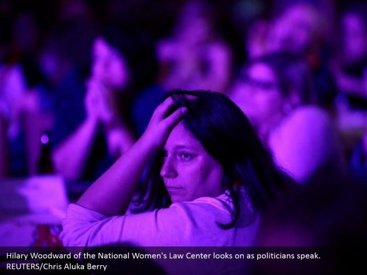 Hilary Woodward of the National Women's Law Center looks on as politicians speak. REUTERS/Chris Aluka Berry