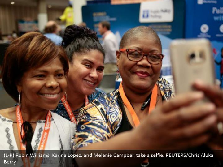 (L-R) Robin Williams, Karina Lopez, and Melanie Campbell take a selfie. REUTERS/Chris Aluka Berry
