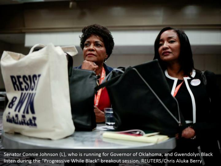 "Senator Connie Johnson (L), who is running for Governor of Oklahoma, and Gwendolyn Black listen during the ""Progressive While Black"" breakout session. REUTERS/Chris Aluka Berry"