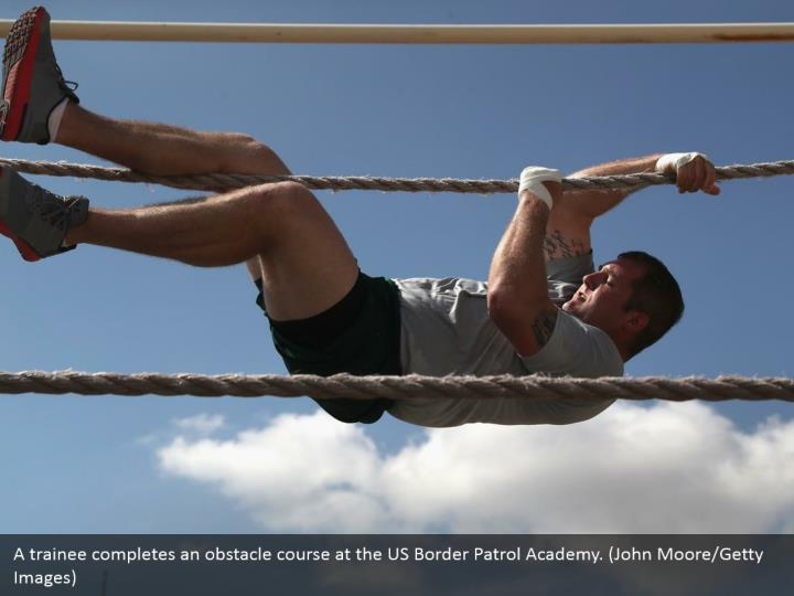 A trainee completes an obstacle course at the US Border Patrol Academy. (John Moore/Getty Images)