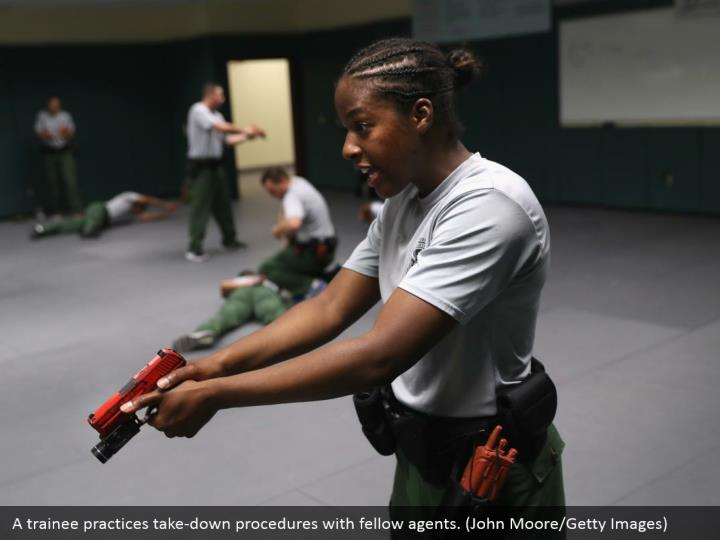 A trainee practices take-down procedures with fellow agents. (John Moore/Getty Images)