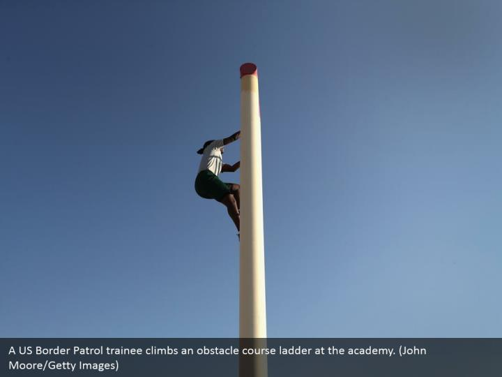 A US Border Patrol trainee climbs an obstacle course ladder at the academy. (John Moore/Getty Images)