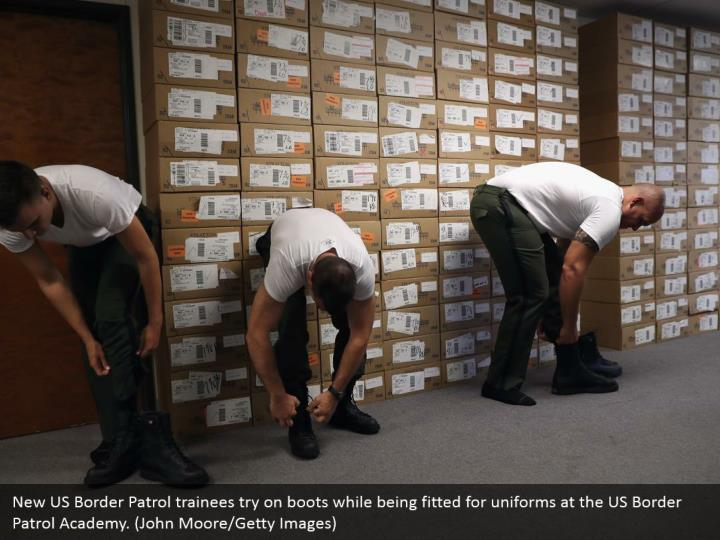 New US Border Patrol trainees try on boots while being fitted for uniforms at the US Border Patrol Academy. (John Moore/Getty Images)