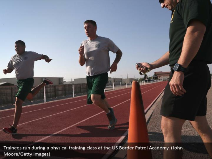 Trainees run during a physical training class at the US Border Patrol Academy. (John Moore/Getty Images)