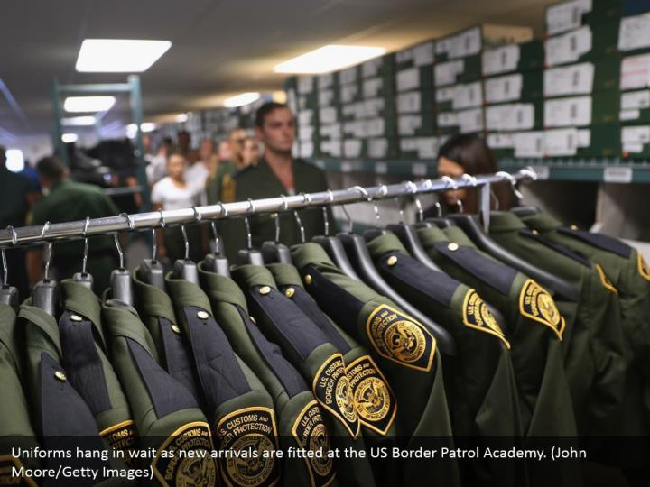 Uniforms hang in wait as new arrivals are fitted at the US Border Patrol Academy. (John Moore/Getty Images)