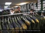 uniforms hang in wait as new arrivals are fitted
