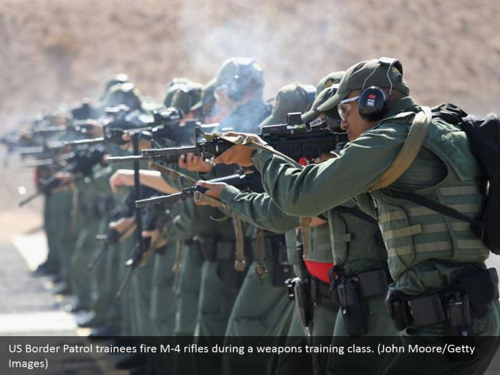 US Border Patrol trainees fire M-4 rifles during a weapons training class. (John Moore/Getty Images)