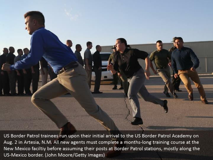 US Border Patrol trainees run upon their initial arrival to the US Border Patrol Academy on Aug. 2 in Artesia, N.M. All new agents must complete a months-long training course at the New Mexico faciltiy before assuming their posts at Border Patrol stations, mostly along the US-Mexico border. (John Moore/Getty Images)