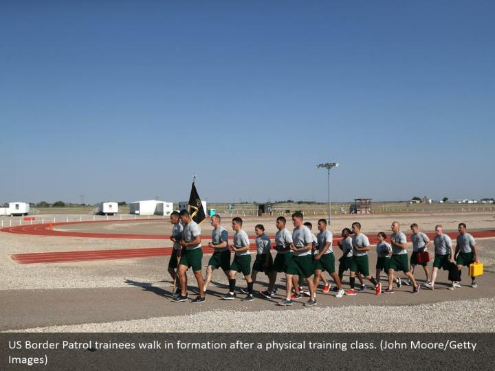 US Border Patrol trainees walk in formation after a physical training class. (John Moore/Getty Images)