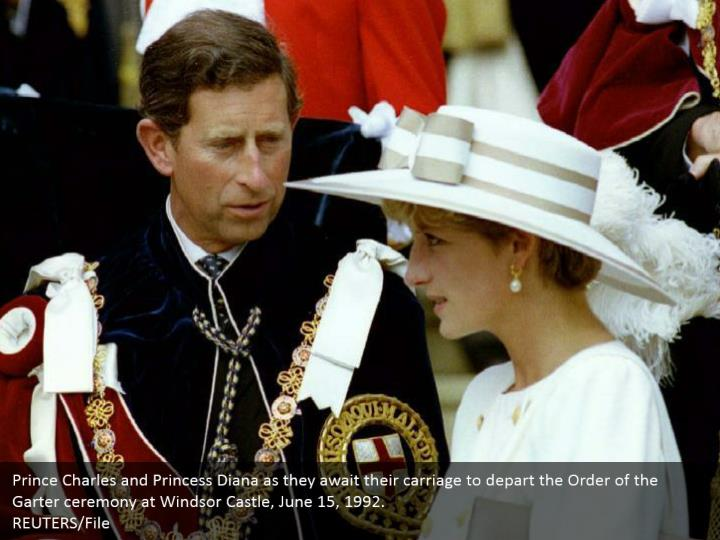 Prince Charles and Princess Diana as they await their carriage to depart the Order of the Garter ceremony at Windsor Castle, June 15, 1992.  REUTERS/File