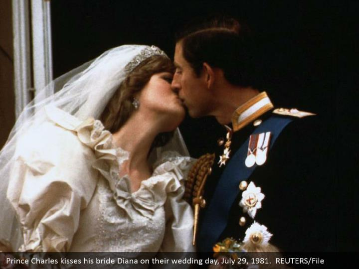 Prince Charles kisses his bride Diana on their wedding day, July 29, 1981.  REUTERS/File