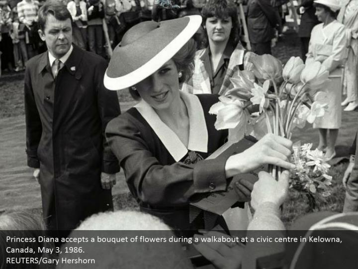 Princess Diana accepts a bouquet of flowers during a walkabout at a civic centre in Kelowna, Canada, May 3, 1986.  REUTERS/Gary Hershorn