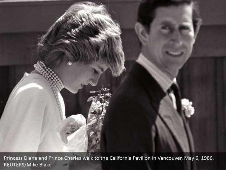 Princess Diana and Prince Charles walk to the California Pavilion in Vancouver, May 6, 1986.  REUTERS/Mike Blake