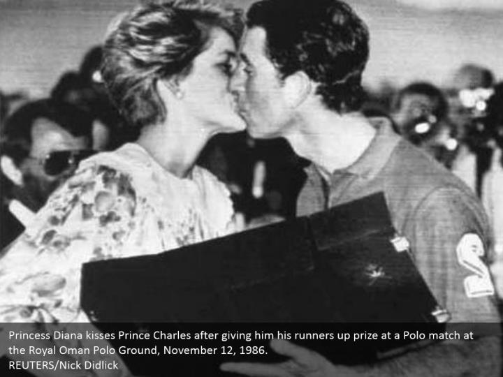 Princess Diana kisses Prince Charles after giving him his runners up prize at a Polo match at the Royal Oman Polo Ground, November 12, 1986.  REUTERS/Nick Didlick