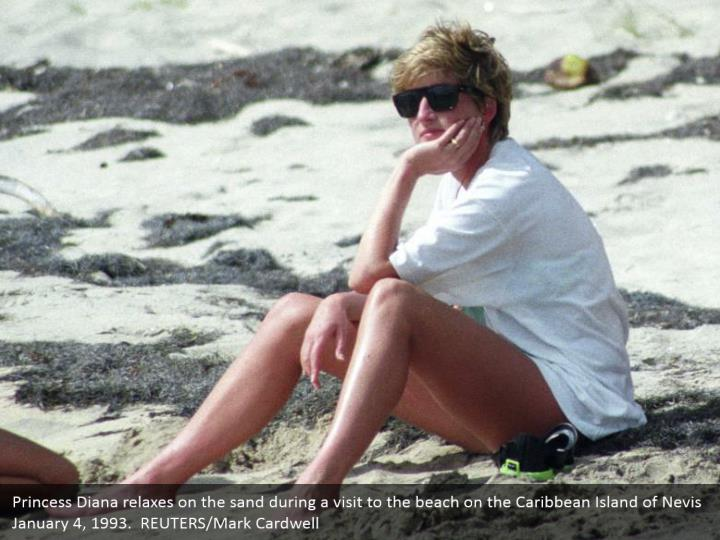 Princess Diana relaxes on the sand during a visit to the beach on the Caribbean Island of Nevis January 4, 1993.  REUTERS/Mark Cardwell