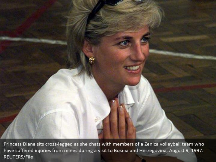 Princess Diana sits cross-legged as she chats with members of a Zenica volleyball team who have suffered injuries from mines during a visit to Bosnia and Herzegovina, August 9, 1997.  REUTERS/File
