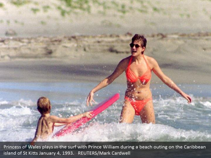 Princess of Wales plays in the surf with Prince William during a beach outing on the Caribbean island of St Kitts January 4, 1993.   REUTERS/Mark Cardwell