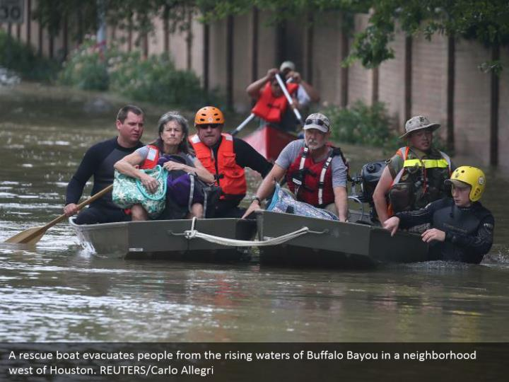 A rescue boat evacuates people from the rising waters of Buffalo Bayou in a neighborhood west of Houston. REUTERS/Carlo Allegri