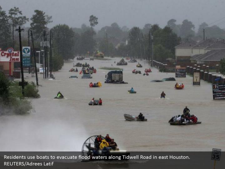Residents use boats to evacuate flood waters along Tidwell Road in east Houston. REUTERS/Adrees Latif