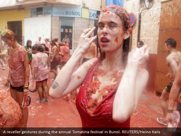 A reveller gestures during the annual Tomatina festival in Bunol. REUTERS/Heino Kalis