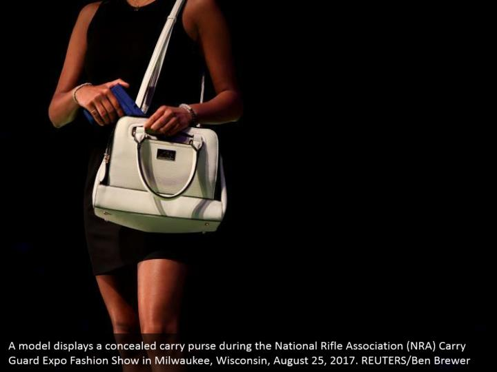 A model displays a concealed carry purse during