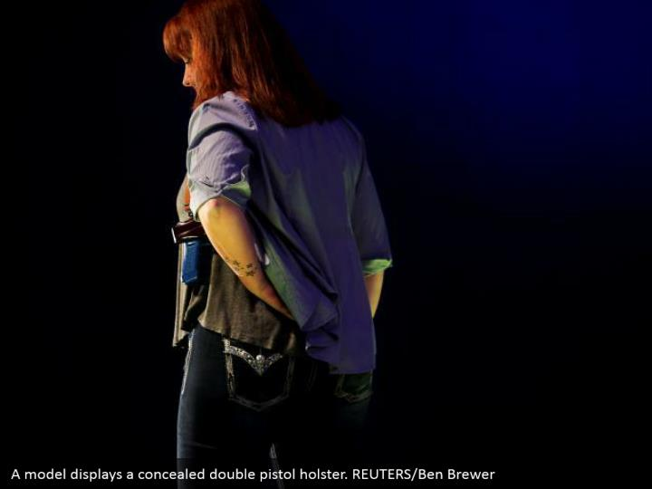 A model displays a concealed double pistol holster. REUTERS/Ben Brewer