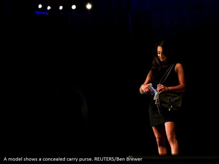 A model shows a concealed carry purse. REUTERS/Ben Brewer