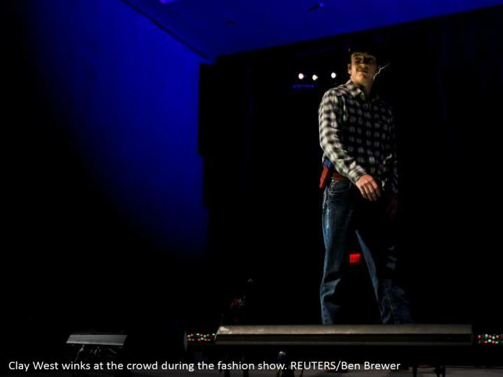 Clay West winks at the crowd during the fashion show. REUTERS/Ben Brewer