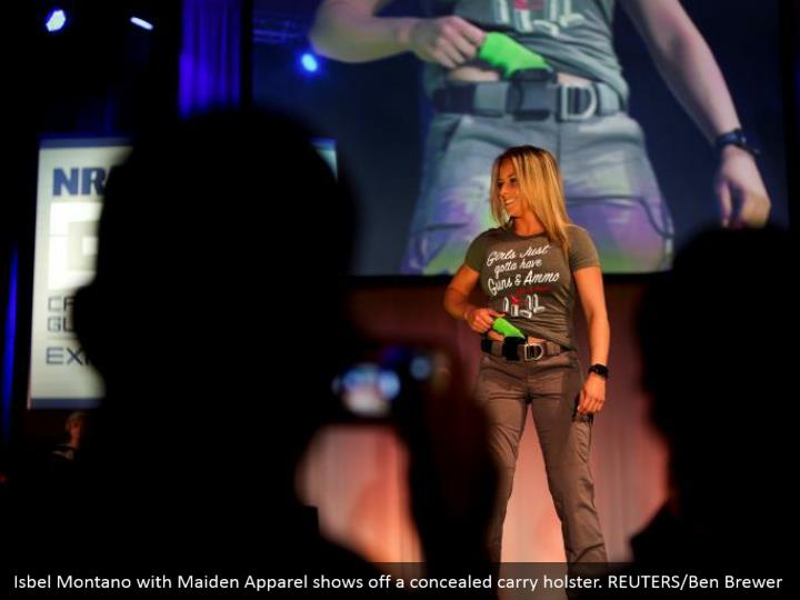 Isbel Montano with Maiden Apparel shows off a concealed carry holster. REUTERS/Ben Brewer