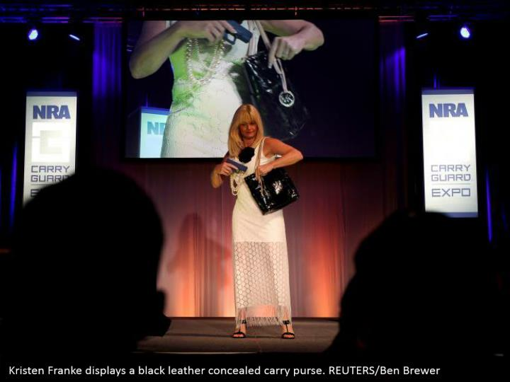 Kristen Franke displays a black leather concealed carry purse. REUTERS/Ben Brewer
