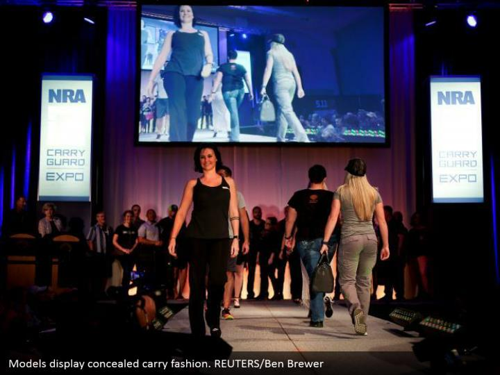 Models display concealed carry fashion. REUTERS/Ben Brewer