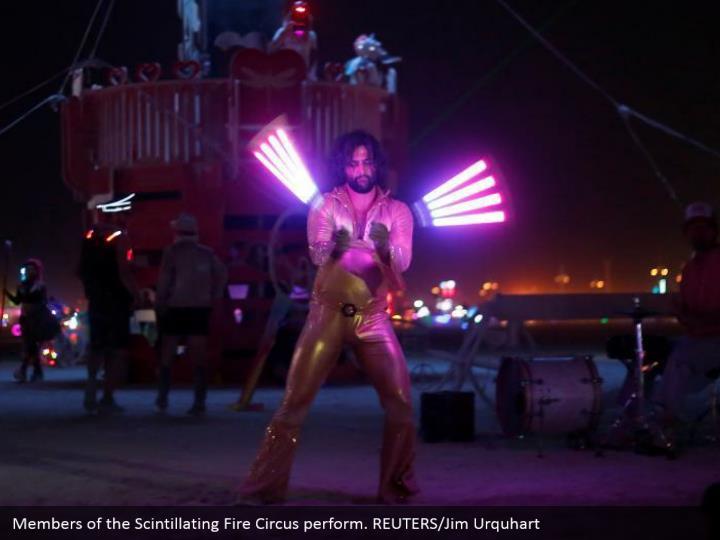 Members of the Scintillating Fire Circus perform. REUTERS/Jim Urquhart