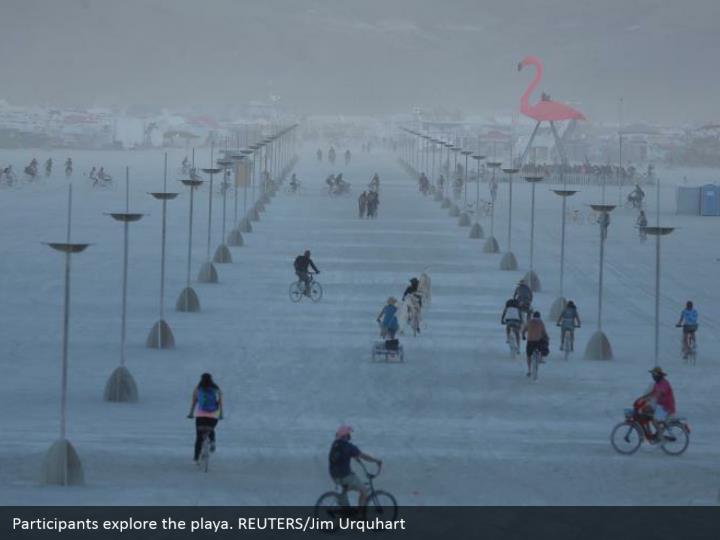Participants explore the playa. REUTERS/Jim Urquhart