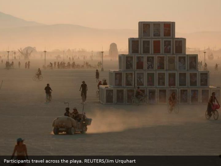 Participants travel across the playa. REUTERS/Jim Urquhart