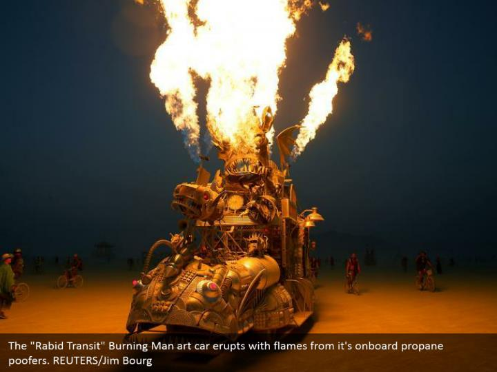 "The ""Rabid Transit"" Burning Man art car erupts with flames from it's onboard propane poofers. REUTERS/Jim Bourg"